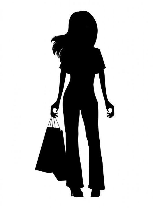 Illustration - silhouette of a woman with shopping bags